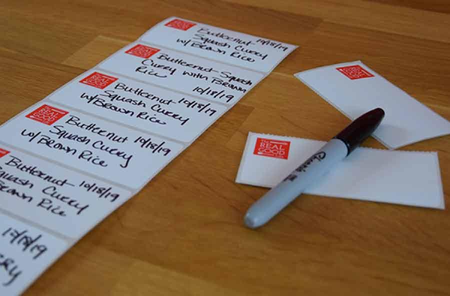 Labels being handwritten with a Sharpie