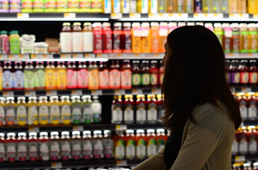 Image of person looking at beverages on store shelf